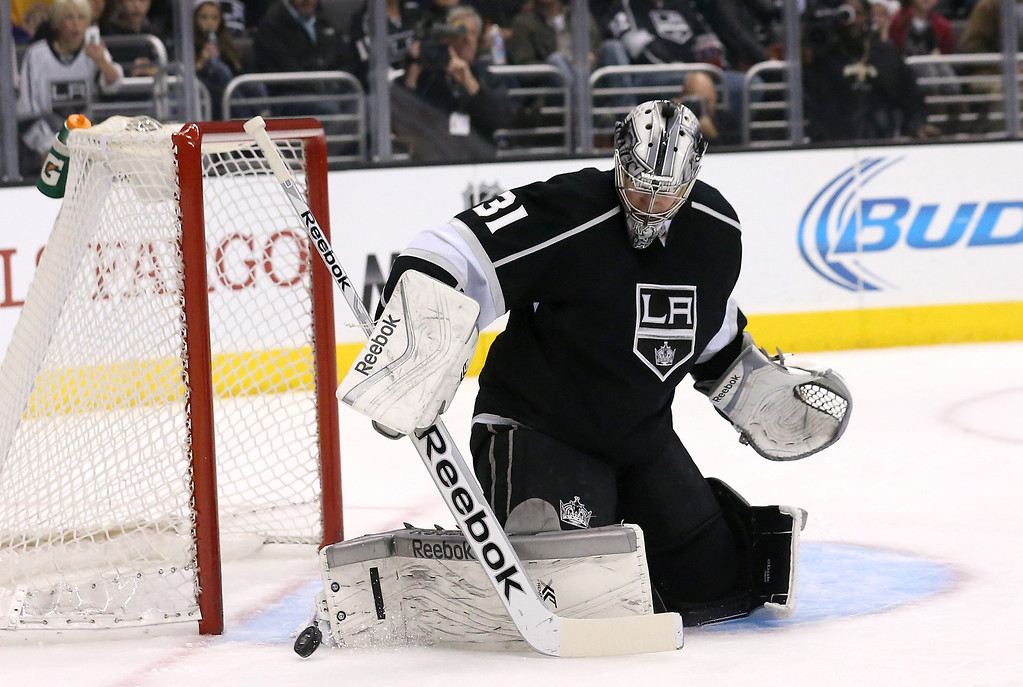 . LOS ANGELES, CA - DECEMBER 21:  Goalie Martin Jones #31 of the Los Angeles Kings blocks a shot against the Colorado Avalanche at Staples Center on December 21, 2013 in Los Angeles, California.  (Photo by Stephen Dunn/Getty Images)
