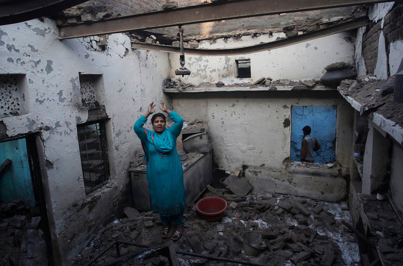 . A Pakistani Christian woman reacts after her home was damaged by an angry Muslim mob in Lahore, Pakistan, Sunday, March 10, 2013. Hundreds of Christians clashed with police in eastern and southern Pakistan on Sunday, a day after a Muslim mob burned dozens of homes owned by members of the minority religious group in retaliation for alleged insults against Islam\'s Prophet Muhammad. (AP Photo/K.M. Chaudary)