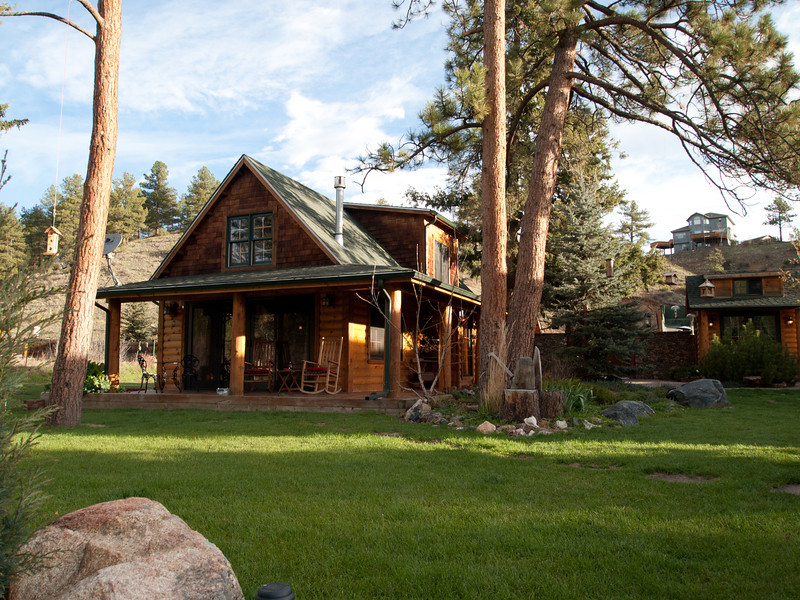 Here is an exterior view of the cottage in Evergreen, CO.  The small building to the right is a reading room.  Further to the right is the other cottage as well as a little  sauna.