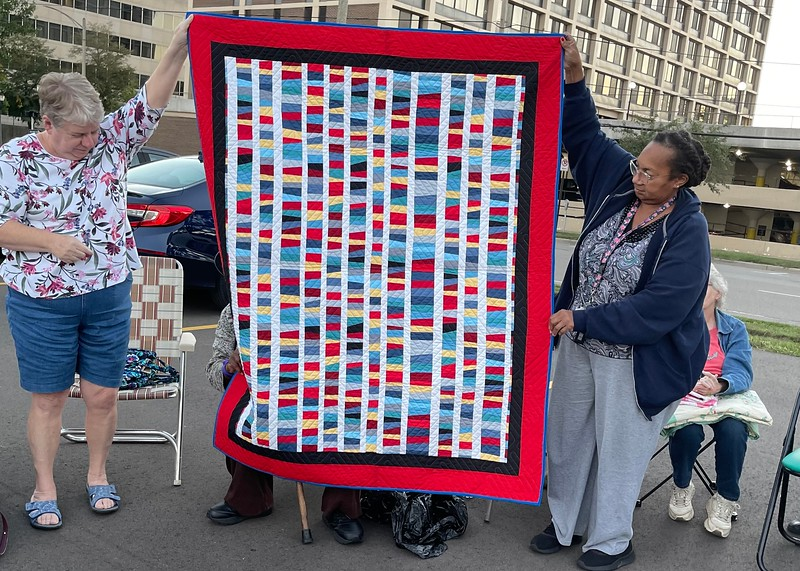 I think Donna Arnold is behind the quilt and she made this.  Its origins are a secret.