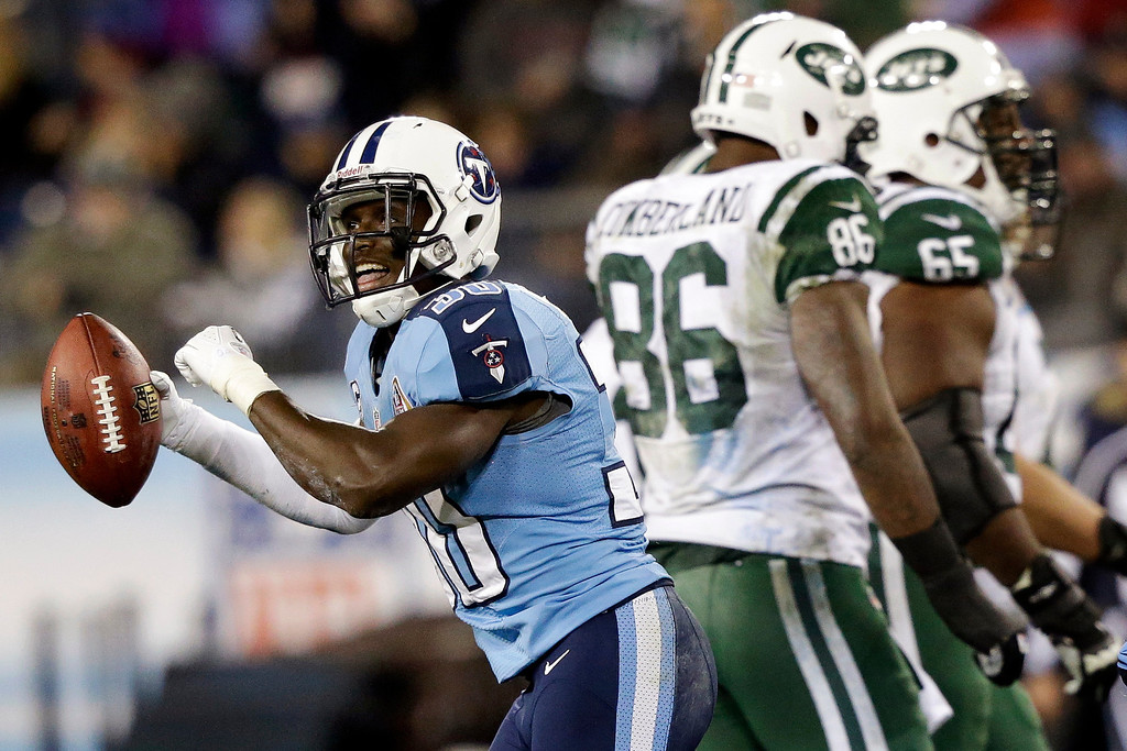 . Tennessee Titans cornerback Jason McCourty (30) celebrates after intercepting a pass from New York Jets quarterback Mark Sanchez, not shown, intended for tight end Jeff Cumberland (86) in the third quarter of an NFL football game, Monday, Dec. 17, 2012, in Nashville, Tenn. Jets\' Brandon Moore (65) walks off the field. (AP Photo/Wade Payne)
