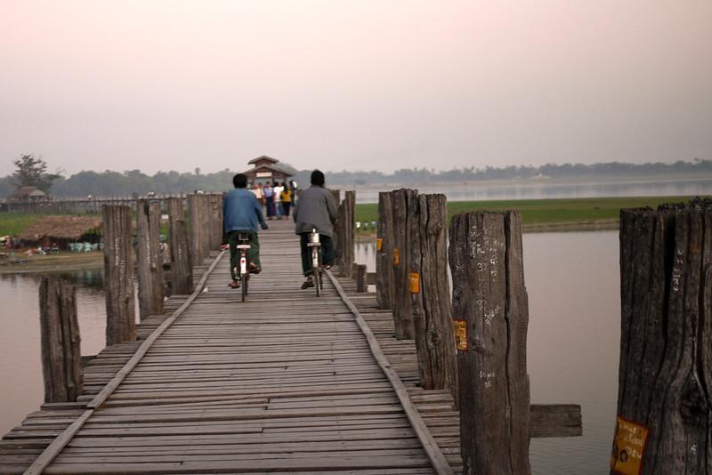 Bikes and a sunset on U Bein Bridge near Mandalay, Burma.