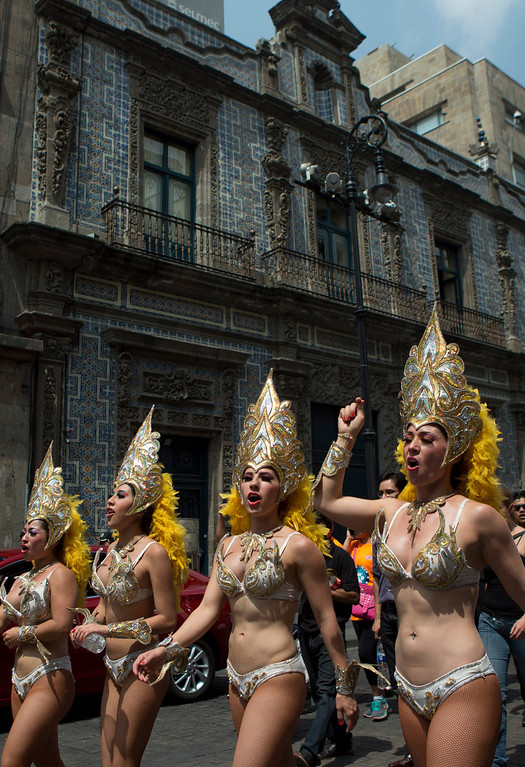 . Circus performers march to protest a new city ban on animals in circuses in Mexico City, Tuesday, June 10, 2014. Circus performers say the law will leave both animals and humans unemployed. (AP Photo/Rebecca Blackwell)