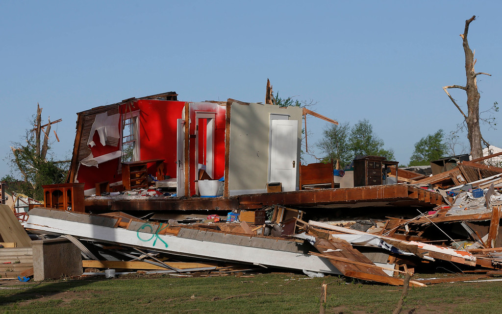 . The remains of a home damaged by a tornado Sunday evening stands in Baxter Springs, Kan., Monday, April 28, 2014. The tornado left a trail of shattered homes, twisted metal and hanging power lines. (AP Photo/Orlin Wagner)