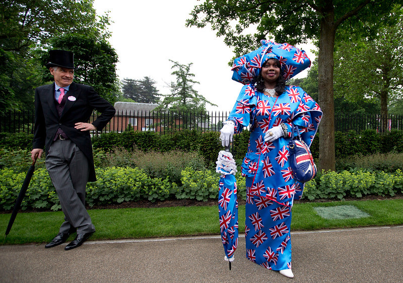 . Genie Williams dressed in a union jack dress and hat outfit poses for the media on the third day traditionally known as Ladies Day of the Royal Ascot horse race meeting in Ascot, England, Thursday, June 20, 2013. (AP Photo/Alastair Grant)