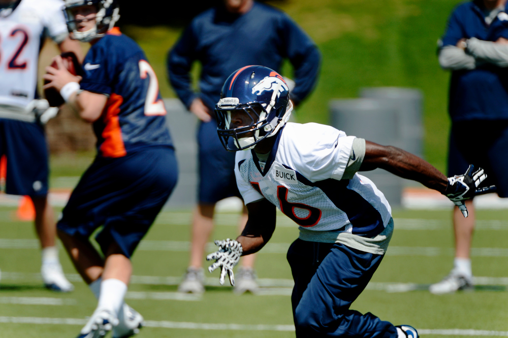 . Rookie quarterback # 2 Zac Dysert drops back as wide receiver # 16 Quincy McDuffie takes off from the line during Broncos rookie minicamp at the Broncos Dove Valley facility May 10, 2013 Centennial, Colorado. (Photo By Joe Amon/The Denver Post)