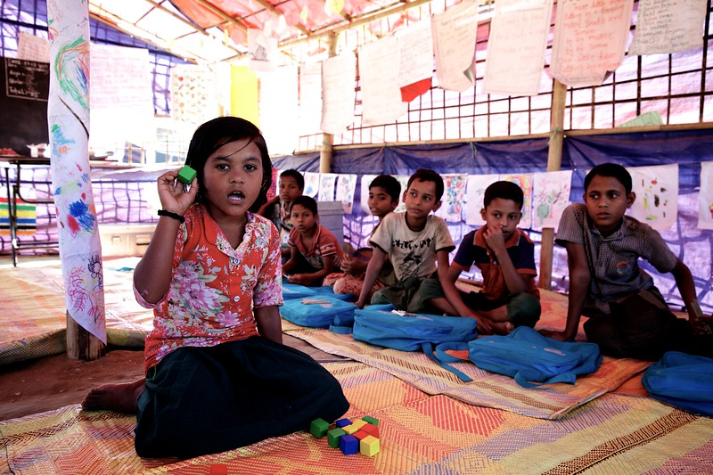 0118Anjali, an 8-year-old Rohingya child, attends classes at a UNICEF-supported learning centre at the Balukhali makeshift settlement for Rohingya refugees in Ukhia, Cox's Bazar, Bangladesh.     Photo: UNICEF / b.a.sujaN/Map