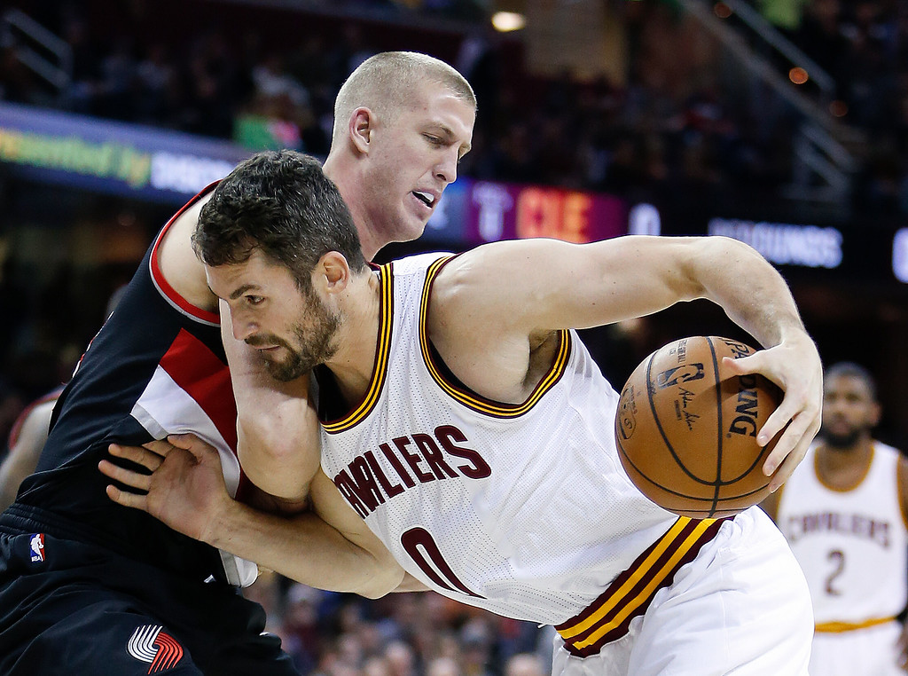 . Cleveland Cavaliers\' Kevin Love (0) drives on Portland Trail Blazers\' Mason Plumlee (24) during the first half of an NBA basketball game Wednesday, Nov. 23, 2016, in Cleveland. (AP Photo/Ron Schwane)