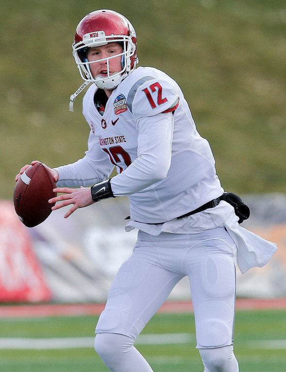 . Washington State quarterback Connor Halliday (12) looks to throw against Colorado State during the first half of the NCAA New Mexico Bowl college football game on Saturday, Dec. 21, 2013, in Albuquerque, N.M. (AP Photo/Matt York)