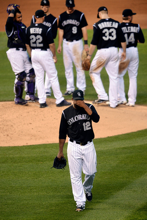 . Colorado starting pitcher Juan Nicasio walked to the dugout after being removed from the game. The Colorado Rockies hosted the Atlanta Braves Tuesday night, June 10, 2014. (Photo by Karl Gehring/The Denver Post)