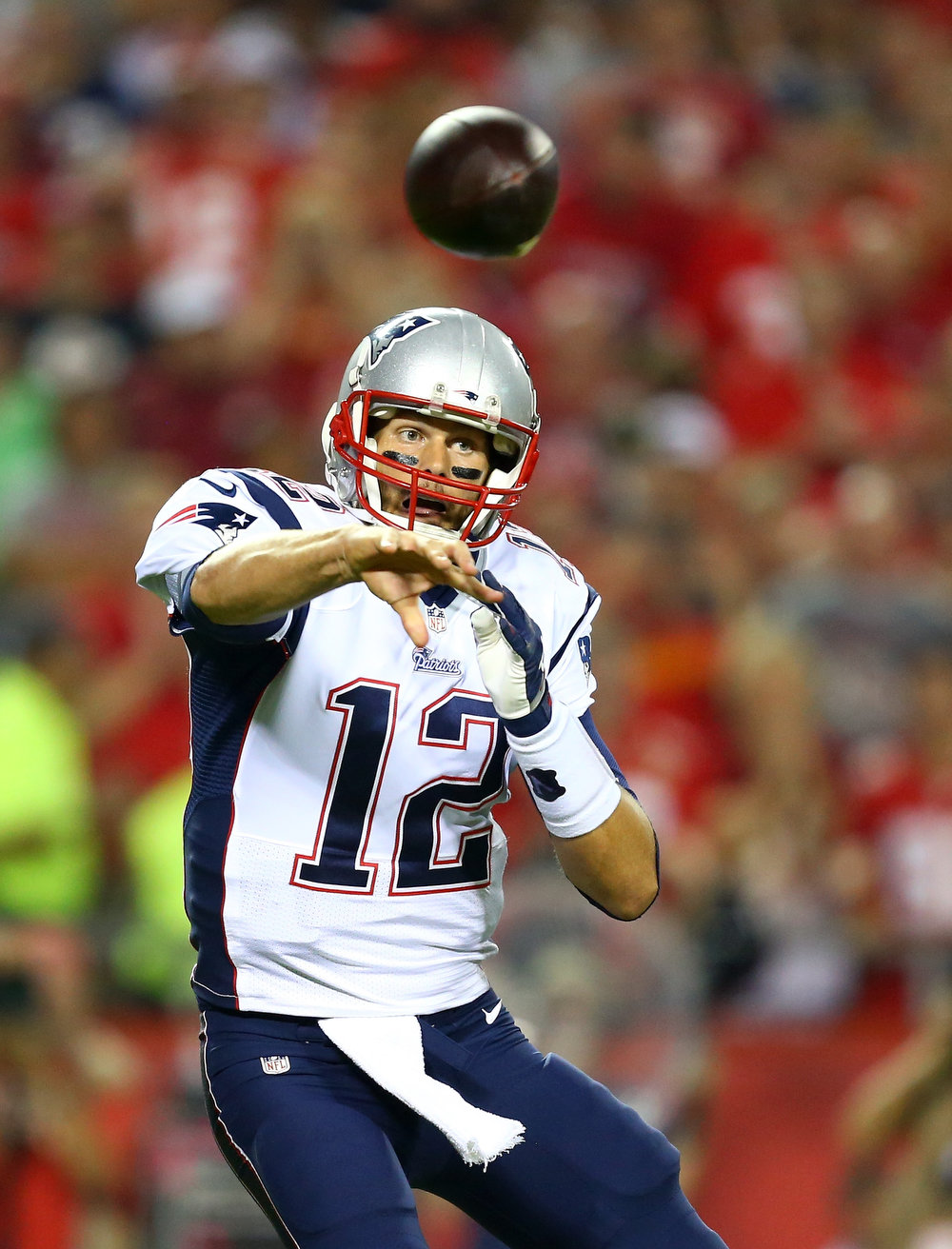 . Tom Brady #12 of the New England Patriots passes against the Kansas City Chiefs during the first half at Arrowhead Stadium on September 29, 2014 in Kansas City, Missouri.  (Photo by Dilip Vishwanat/Getty Images)