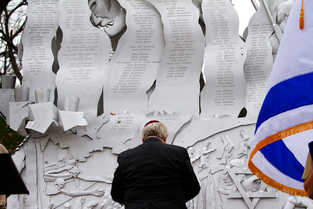. Rabbi Alan Londy of the New Reform Temple of Kansas City, Mo., paused for a moment in front of the memorial to the six million Jews killed during a Holocaust Memorial Service on Sunday, April 7, 2013 at the Jewish Community Campus in Overland Park, Kan. The service commemorates the 70th anniversary of the Warsaw ghetto uprising. It also marked the 50th anniversary of the dedication of the memorial to the six million.