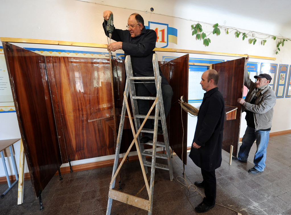 . Workers construct a polling booth in one of the polling station in Sevastopol on March 13, during preparations for the Crimean referendum on March 16.   Austria\'s Freedom Party (FPOe) said Thursday it has declined a Russian invitation sent to it and other far-right parties in Europe to dispatch observers for this weekend\'s disputed referendum in Crimea. VIKTOR DRACHEV/AFP/Getty Images