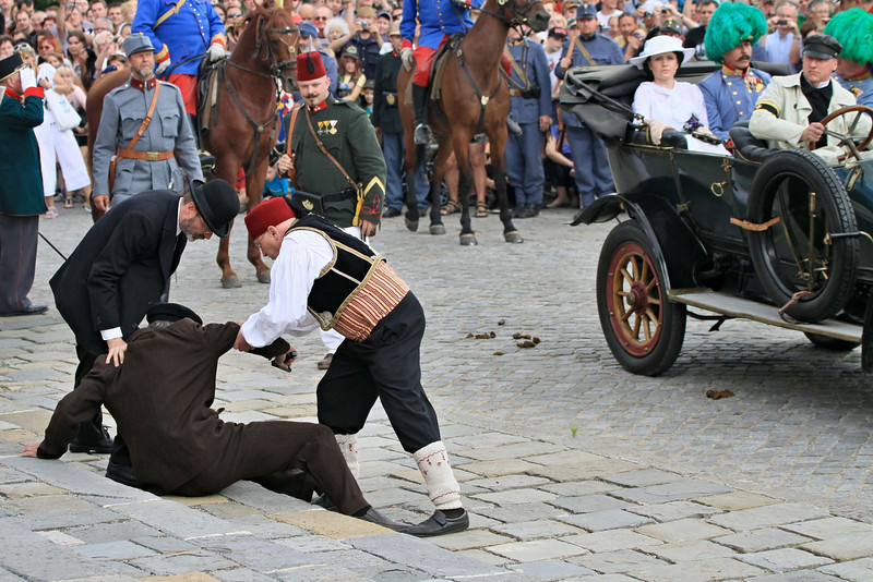 . People reconstruct a scene on June 28, 2014 in Brno, Czech Republic showing Bosnian Serbian Gavrilo Princip (below, L), who assassinated Austrian Archduke Franz Ferdinand (3rd R) and his wife Sophie, Duchess of Hohenberg (4th R) in Sarajevo. Bosnia marked 100 years since the assassination of Ferdinand in Sarajevo that sparked World War I, but the divisive legacy of the gunman Gavrilo Princip meant Serbs were shunning the event. (RADEK MICA/AFP/Getty Images)