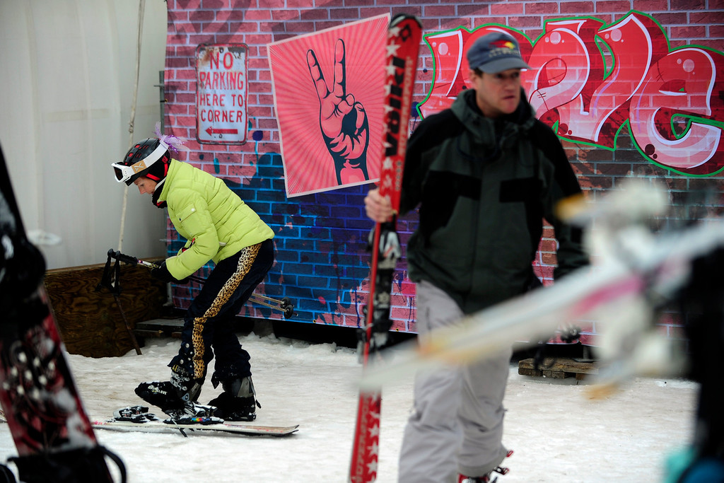 """. ASPEN, CO. - JANUARY 24:   Jan Hubbell, of Basalt, removes her skis after skiing on Buttermilk Mountain during the 2013 Aspen X Games on January 24, 2013   \""""It\'s hard to get through security and parking but it\'s fun seeing everything from up on the hill. i just saw one of them come through and then the next guy wipe out,\"""" Hubbell said. \""""It  brings 75, 000 people to Aspen so it\'s really good for the town. It\'s bother for about a month but we can handle it.\""""  (Photo By Mahala Gaylord / The Denver Post)"""