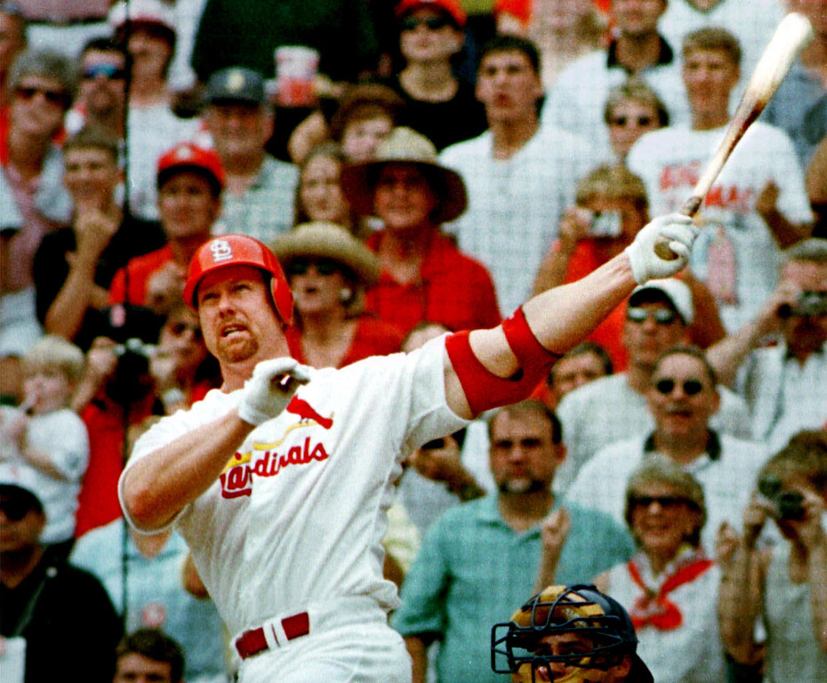 . MARK McGWIRE -- St. Louis slugger Mark McGwire hits his 61st home run of the season against the Chicago Cubs in the first inning in St. Louis on Sept 7, 1998. (AP Photo/Amy Sancetta)