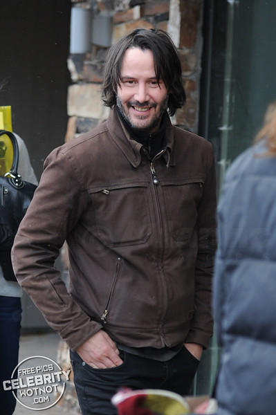 Keanu Reeves Flashes a Smile Showing Off Stubble