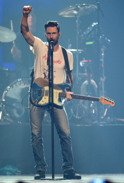 . LAS VEGAS, NV - SEPTEMBER 21:  Singer/guitarist Adam Levine of Maroon 5 performs during the iHeartRadio Music Festival at the MGM Grand Garden Arena on September 21, 2013 in Las Vegas, Nevada.  (Photo by Ethan Miller/Getty Images for Clear Channel)