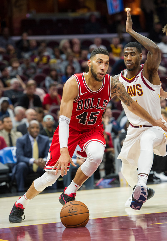 . Chicago Bulls\' Denzel Valentine (45) drives past Cleveland Cavaliers\' Iman Shumpert during the second half of an NBA preseason basketball game in Cleveland, Tuesday, Oct. 10, 2017. The Bulls won 108-94. (AP Photo/Phil Long)