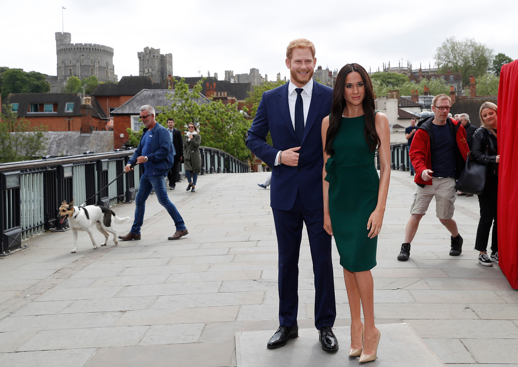 . Waxwork figures of Britain\'s Prince Harry and Meghan Markle on a bridge over the River Thames for a media opportunity against a backdrop of Windsor Castle, in Windsor, England, Wednesday, May 16, 2018. Preparations continue in Windsor ahead of the royal wedding of Britain\'s Prince Harry and Meghan Markle Saturday May 19. (AP Photo/Alastair Grant)
