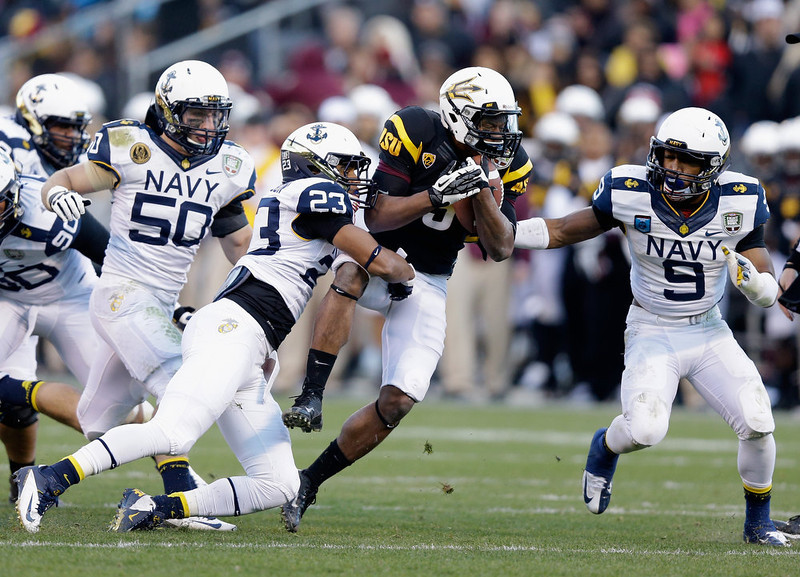 . Deantre Lewis #5 of the Arizona State Sun Devils is tackled by Chris Ferguson #23 of the Navy Midshipmen during the Kraft Fight Hunger Bowl at AT&T Park on December 29, 2012 in San Francisco, California.  (Photo by Ezra Shaw/Getty Images)