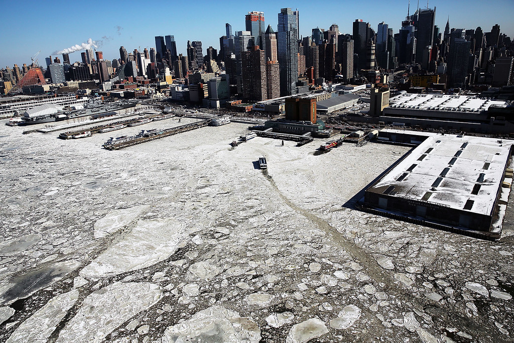 . Ice floes are viewed along the Hudson River in Manhattan on a frigidly cold day February 20, 2015 in New York City. New York, and much of the East Coast and Western United States is experiencing unusually cold weather with temperatures in the teens and the wind chill factor making it feel well below zero.  (Photo by Spencer Platt/Getty Images)