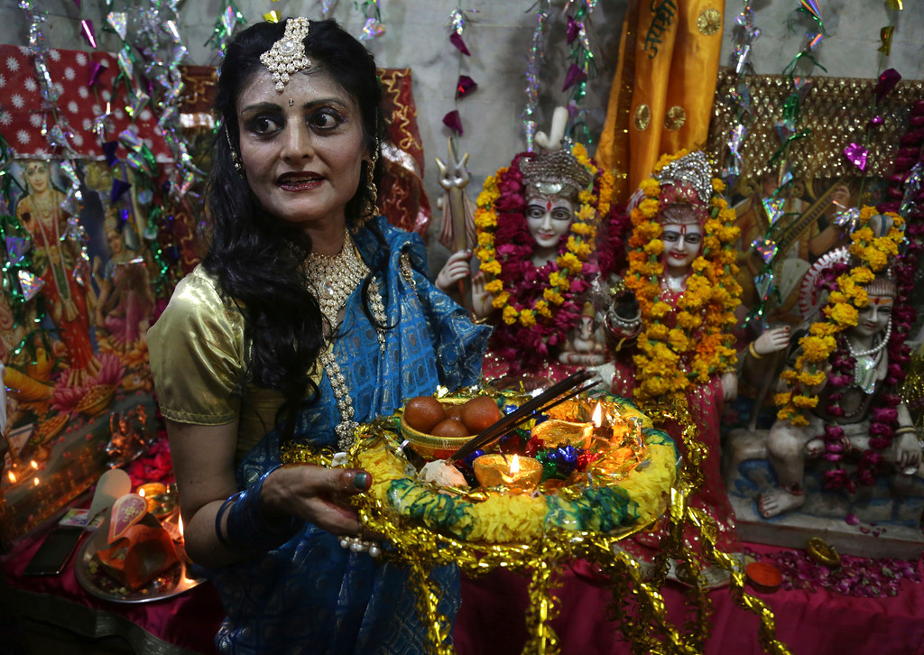 . A Pakistani Hindu woman celebrates Diwali, the Hindu festival of lights, in Lahore, Pakistan, Thursday, Oct. 19, 2017. (AP Photo/K.M. Chaudary)