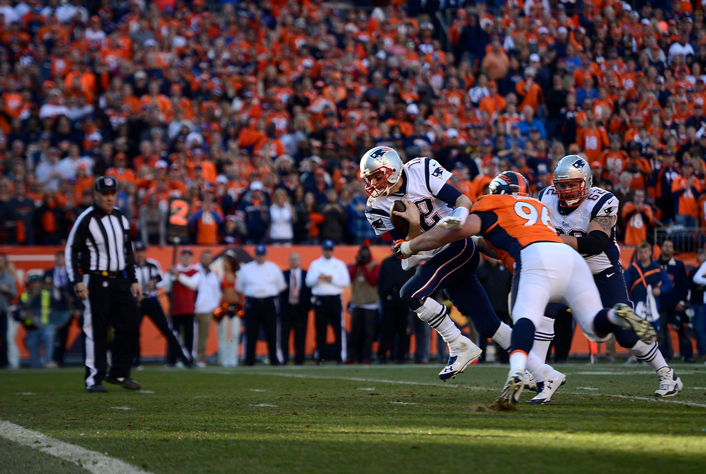 . New England Patriots quarterback Tom Brady (12) runs it in for a touchdown in the fourth quarter. The Denver Broncos take on the New England Patriots in the AFC Championship game at Sports Authority Field at Mile High in Denver on January 19, 2014. (Photo by AAron Ontiveroz/The Denver Post)