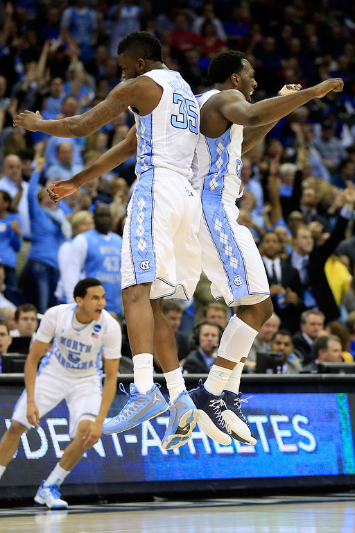 . KANSAS CITY, MO - MARCH 22:  Reggie Bullock #35 and P.J. Hairston #15 of the North Carolina Tar Heels celebrate a moment in the second half against the Villanova Wildcats during the second round of the 2013 NCAA Men\'s Basketball Tournament at the Sprint Center on March 22, 2013 in Kansas City, Missouri.  (Photo by Jamie Squire/Getty Images)