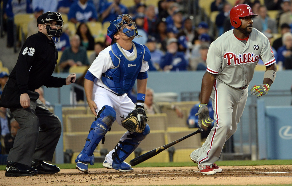 . Philadelphia Phillies\' Ryan Howard watches his single along with Los Angeles Dodgers catcher Tim Federowicz and home plate umpire Mike Estabrook (83) in the second inning of a baseball game on Tuesday, April 22, 2013 in Los Angeles.   (Keith Birmingham/Pasadena Star-News)