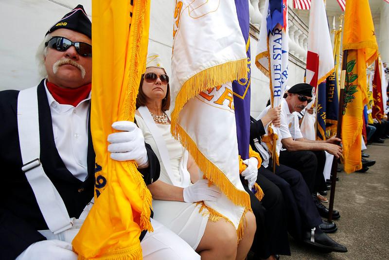 . Flag bearers look on as U.S. President Barack Obama speaks during Memorial Day observances at Arlington National Cemetery in Arlington, Virginia, May 27, 2013. REUTERS/Jonathan Ernst