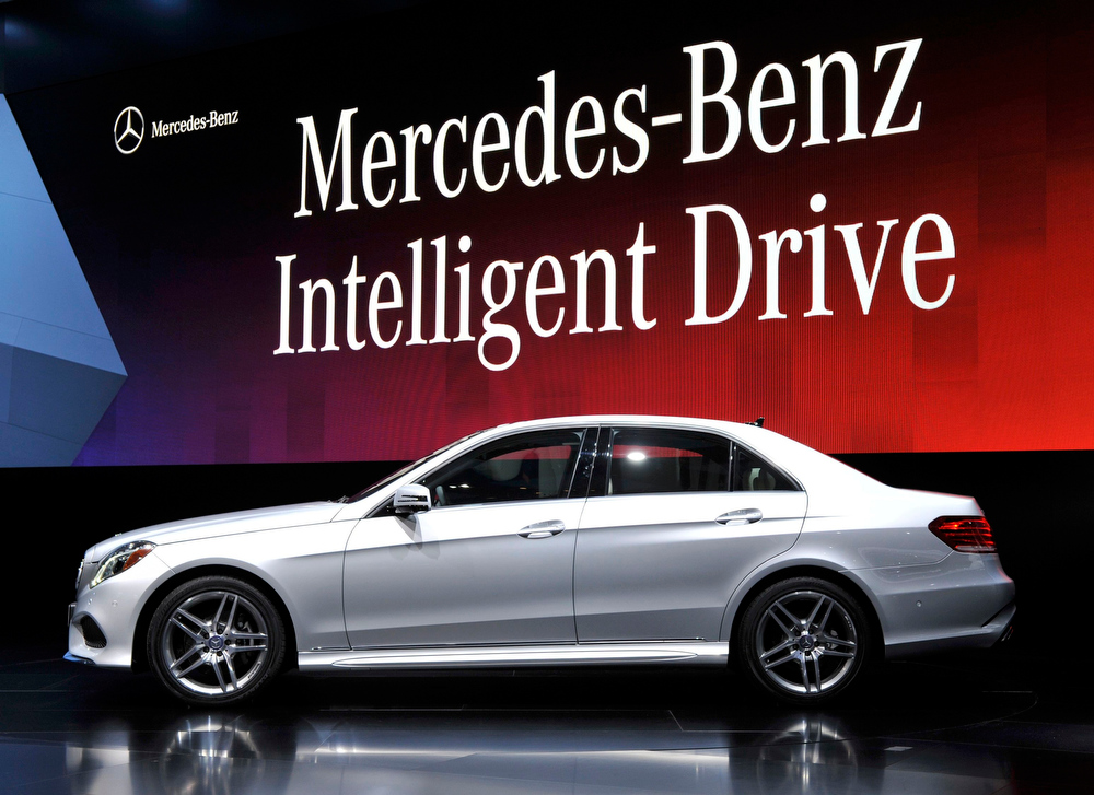 . The 2014 Mercedes Benz E Class 400 hybrid is presented at the North American International Auto Show in Detroit, Michigan January 14, 2013.   REUTERS/James Fassinger