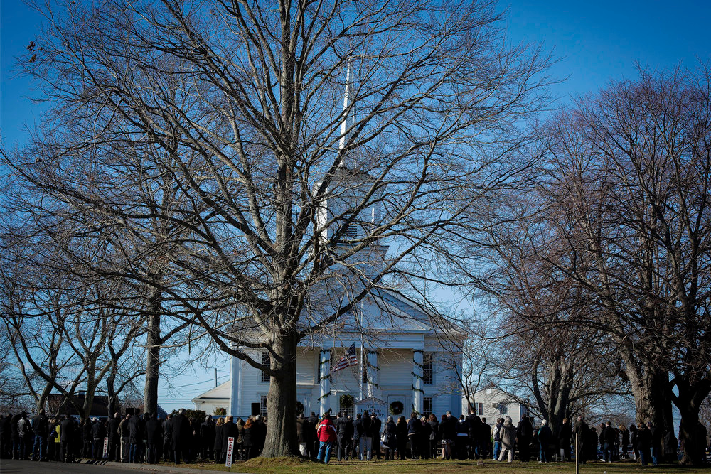 Description of . Mourners attend the funeral service of Sandy Hook Elementary School shooting, teacher victim Victoria Soto, outside Lordship Community Church, in Stratford, Connecticut, December 19, 2012. Six victims of the Newtown school shootings will be honored at funerals and remembrances on Wednesday. REUTERS/Lucas Jackson