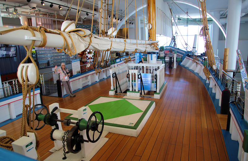 A large sailing ship, the Challenge, indoors.