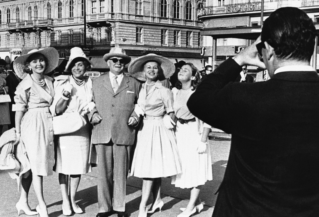 . The Gabor fanily poses for a family photo during reunion on Aug. 22, 1960 in Vienna, Austria. Actress Zsa Zsa Gabor, left, with parents Vilmos Gabor and  Jolie Gabor; Eva Gabor, and Francesca Hilton, Zsa Zsa\'s 13-year-old daughter by a previous marriage.  Taking picture is Eva\'s husband, New York stock broker Richard Brown.   Missing was Magda Gabor.   Father Gabor, who still lives in Communist Hungary, traveled to Vienna for the reunion. (AP Photo)