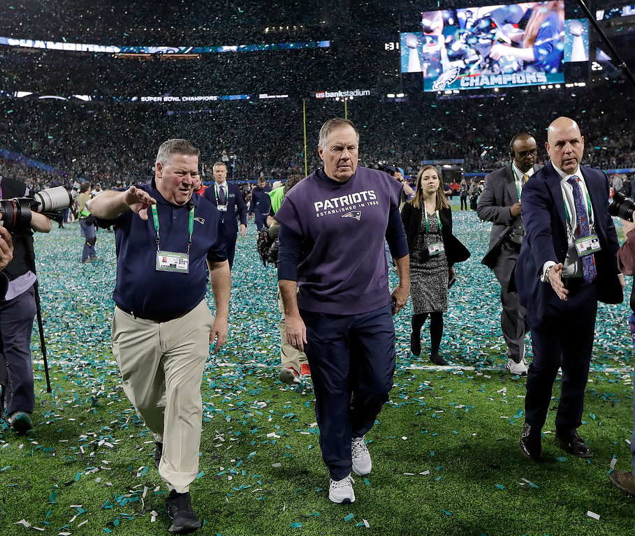 . New England Patriots head coach Bill Belichick, center, walks off the field after the NFL Super Bowl 52 football game against the Philadelphia Eagles Sunday, Feb. 4, 2018, in Minneapolis. The Eagles won 41-33. (AP Photo/Mark Humphrey)