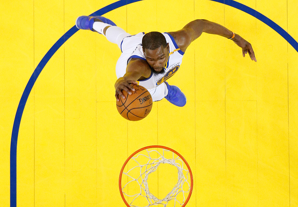 . Golden State Warriors forward Kevin Durant dunks against the Cleveland Cavaliers during the first half of Game 1 of basketball\'s NBA Finals in Oakland, Calif., Thursday, June 1, 2017. (John G. Mabanglo/Pool Photo via AP)