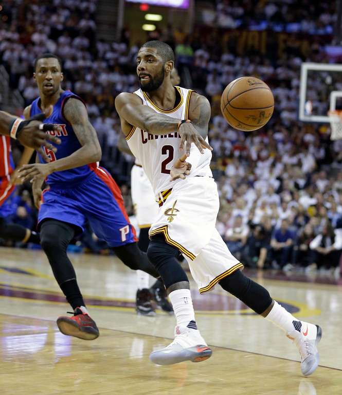 . Cleveland Cavaliers\' Kyrie Irving (2) passes the ball against Detroit Pistons\' Kentavious Caldwell-Pope (5) in the first half in Game 2 of a first-round NBA basketball playoff series, Wednesday, April 20, 2016, in Cleveland. (AP Photo/Tony Dejak)