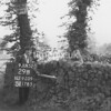 NJ920929B, Man marking Ordnance Survey minor control revision point with an arrow in 1950s