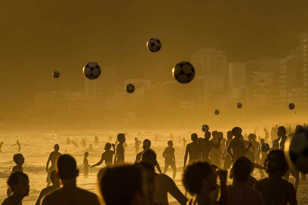 . People play football at sunset at Ipanema Beach in Rio de Janeiro, Brazil on January 9, 2014. AFP PHOTO / YASUYOSHI  CHIBA/AFP/Getty Images