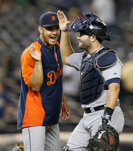 . Detroit Tigers catcher Alex Avila, right, is congratulated by a teammate at the conclusion of the Tigers\' 12-inning, 4-3 victory over the New York Yankees in a baseball game at Yankee Stadium in New York, Tuesday, Aug. 5, 2014. Avila hit the game-ahead solo home run off New York Yankees relief pitcher Matt Daley. (AP Photo/Kathy Willens)