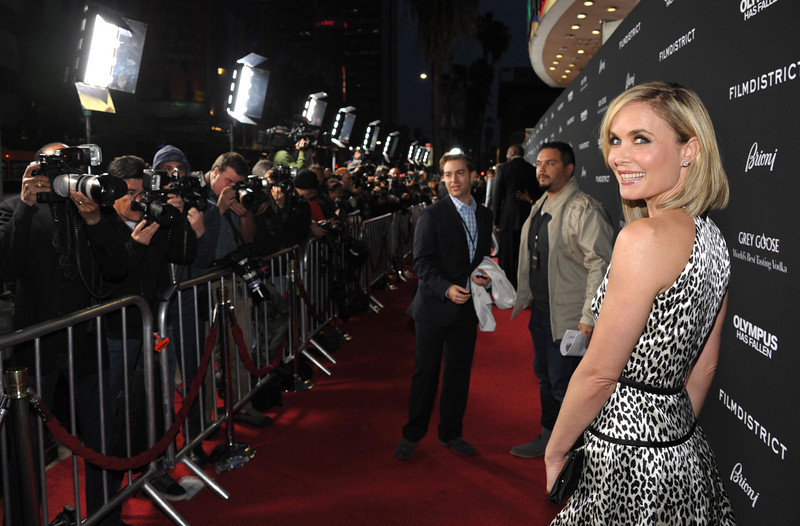 """. Radha Mitchell arrives at the premiere of \""""Olympus Has Fallen\"""" at the ArcLight Theatre on Monday, March 18, 2013 in Los Angeles. (Photo by John Shearer/Invision/AP)"""