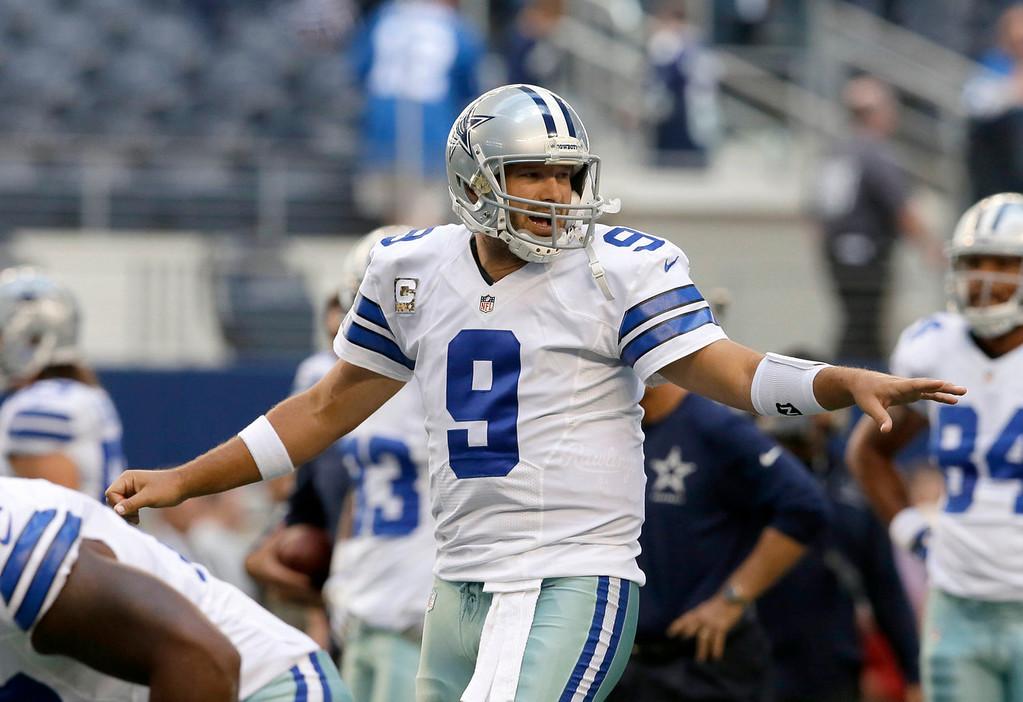 . Dallas Cowboys quarterback Tony Romo (9) signals to a teammate during warm ups at an NFL football game against the Minnesota Vikings, Sunday, Nov. 3, 2013, in Arlington, Texas. (AP Photo/Tim Sharp)