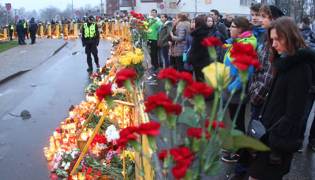 . People lay down flowers and candles at the accident site of a collapsed Maxima supermarket in Riga on November 23, 2013, where the roof of the building caved in on shoppers on November 21.     AFP PHOTO / PETRAS  MALUKAS/AFP/Getty Images