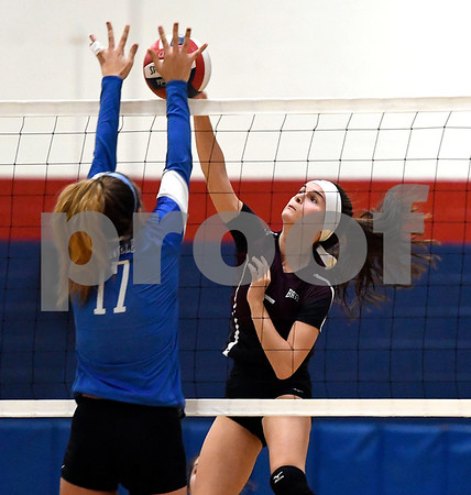 10/19/2017 Mike Orazzi   Staff Plainville's Katharine Tanguay (17) and Bristol Central's Brianna Saverino (5) during Thursday's volleyball match in Plainville.