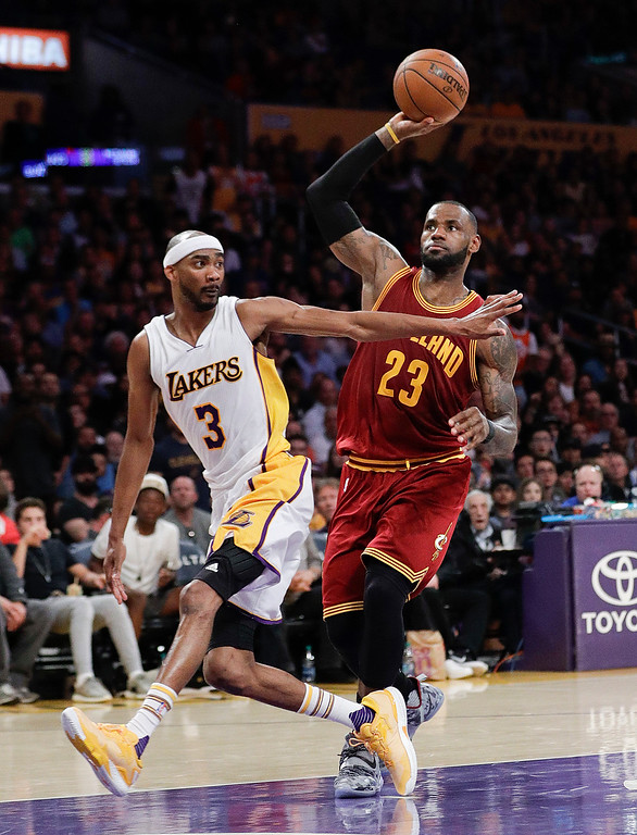 . Cleveland Cavaliers\' LeBron James, right, drives toward the basket under defense by Los Angeles Lakers\' Corey Brewer during the second half of an NBA basketball game Sunday, March 19, 2017, in Los Angeles. The Cavaliers won 125-120. (AP Photo/Jae C. Hong)