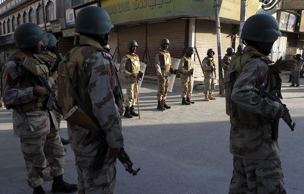 . Pakistani paramilitary soldiers stand guard during a procession by Shiite Muslim devotees on the seventh day of the Muslim month of Muharram in Quetta on November 1, 2014. BANARAS KHAN/AFP/Getty Images
