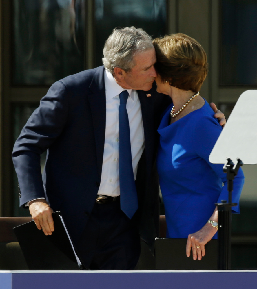 Description of . Former president George W. Bush hugs his wife Barbara Bush during the dedication of the George W. Bush Presidential Center Thursday, April 25, 2013, in Dallas. (AP Photo/David J. Phillip)