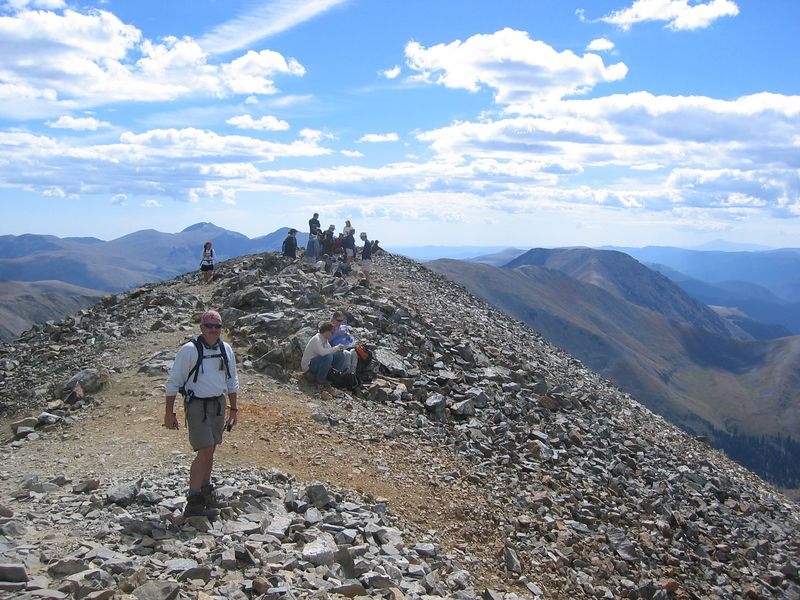 Mt. Evans (14,260') directly behind Rick; Mt. Bierstadt (14,060') to right of Evans. .. Pikes Pk (14,110') is distant summit on right.