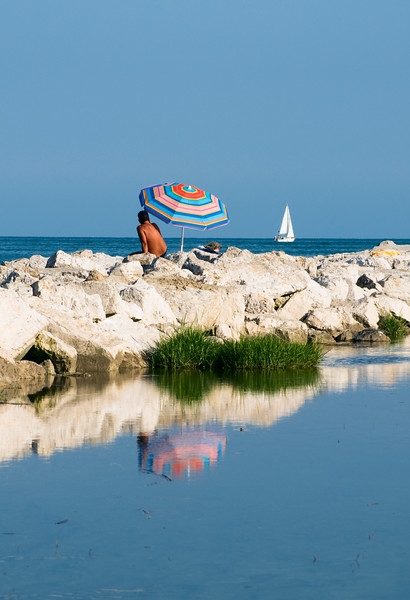 Man with Umbrella on Beach, Caorle, Italy